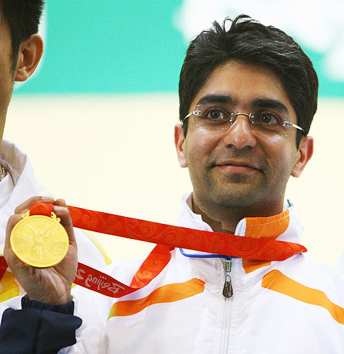 Abhinav Bindra of India poses with his gold medal