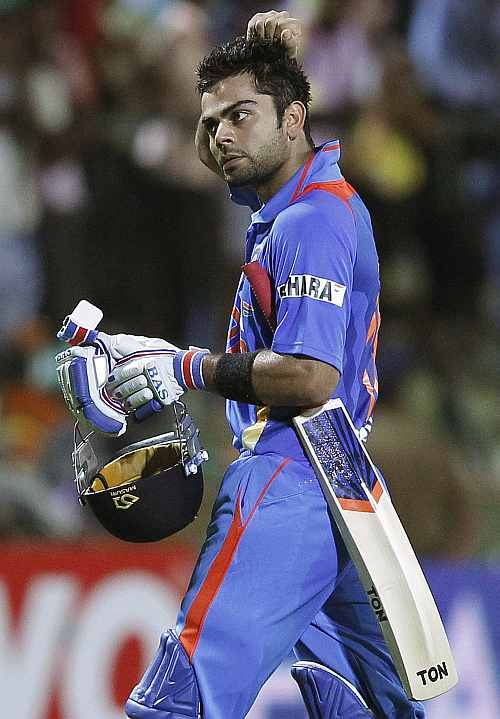 India's Virat Kohli reacts as he walks off the field after his dismissal during the Twenty20 match against Sri Lanka