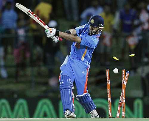India's Gautam Gambhir is bowled out by Sri Lanka's Shaminda Eranga during their Twenty20 match in Pallekele
