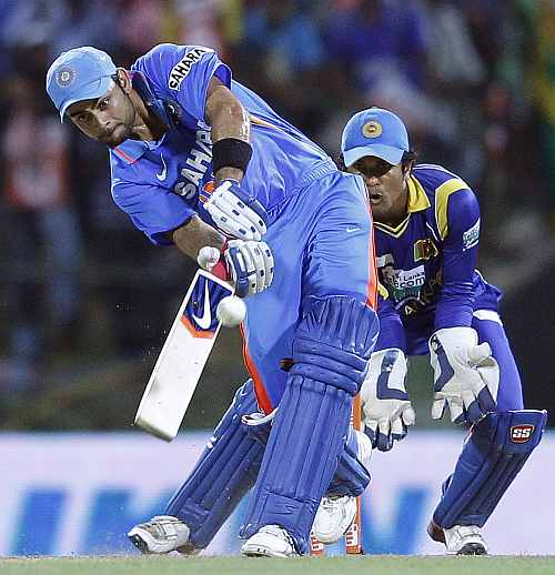 India's Virat Kohli (L) plays a shot during their Twenty20 match against Sri Lanka in Pallekele