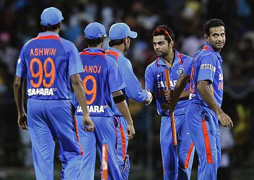 India's Virat Kohli celebrates with his teammates after winning their Twenty20 cricket match against Sri Lanka