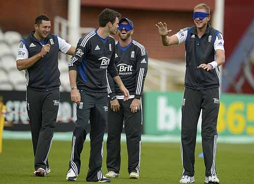 England's Tim Bresnan and James Anderson guide a blindfolded Prior and Broad during training session in London
