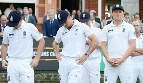 England captain Andrew Strauss waits with Ian Bell and Jonathan Bairstow