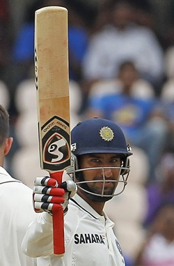 Cheteshwar Pujara celebrates after getting to hundred