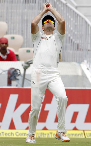 New Zealand's James Franklin takes a catch off the bowling of Jeetan Patel to dismiss Cheteshwar Pujara