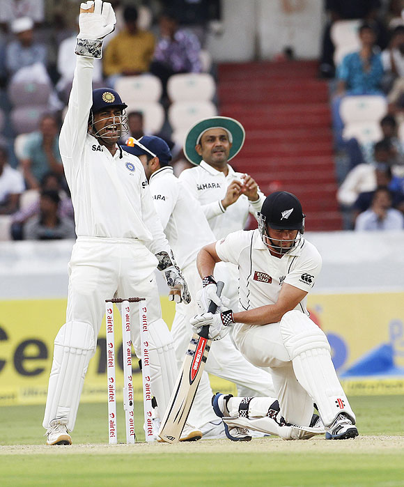 Mahendra Singh Dhoni (left) makes a successful LWB appeal for the wicket of New Zealand's Daniel Flynn (right) off the bowling of Ravichandran Ashwin