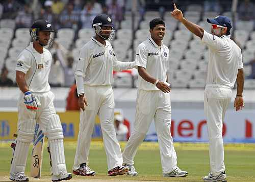 India's Virat Kohli gestures after India's Umesh Yadav took the wicket of New Zealand's Kruger Van Wyk