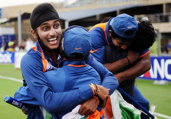 Harmeet Singh (left) celebrates with team-mates