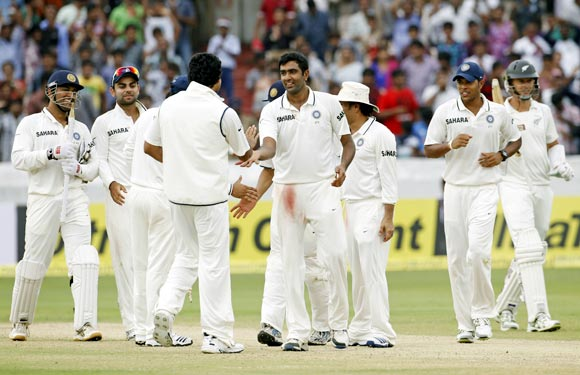 The Indian team celebrate after winning the first Test