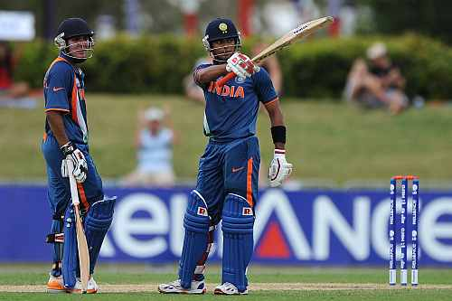 Unmukt Chand (R) of India celebrates reaching his century during the 2012 ICC U19 Cricket World Cup Final between Australia and India