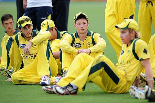 Australian players look dejected after the 2012 ICC U19 Cricket World Cup Final between Australia and India