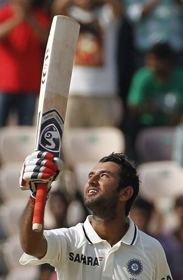Cheteshwar Pujara celebrates after getting to hundred on Day 1 of the first Test against   New Zealand