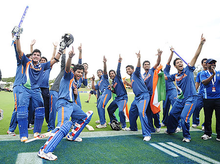 Unmukt Chand (left) celebrates with teammates after winning the Under-19 World Cup on Sunday