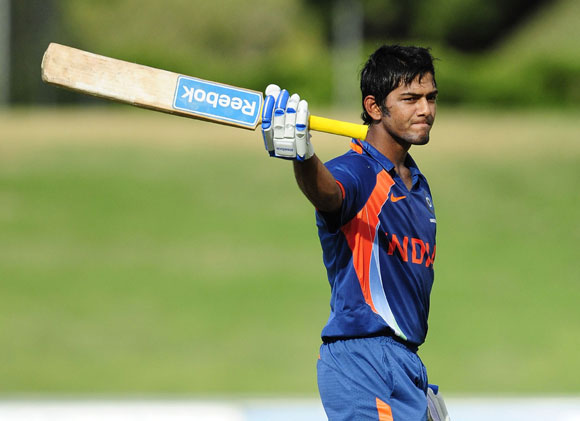 Unmukt Chand of India waves to the crowd after scoring century during the match against Australia on day five of the U19 International Quad Series at Tony Ireland Stadium on April 15, 2012