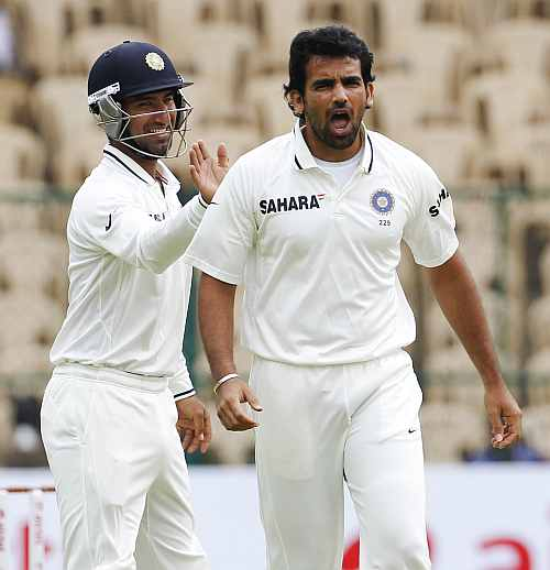 ndia's Zaheer Khan celebrates after taking the wicket of New Zealand's Brendon McCullum during the first day of their second Test match in Bangalore