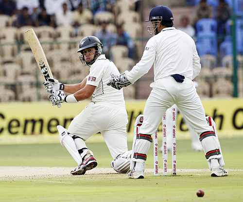 Ross Taylor plays a sweep shot during the first day of the second Test in Bangalore