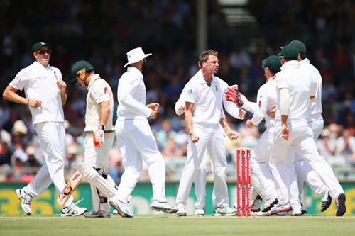 Dale Steyn of South Africa celebrates dismissing David Warner