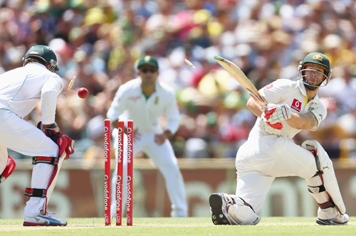 Matthew Wade of Australia is bowled by Robin Peterson of South Africa