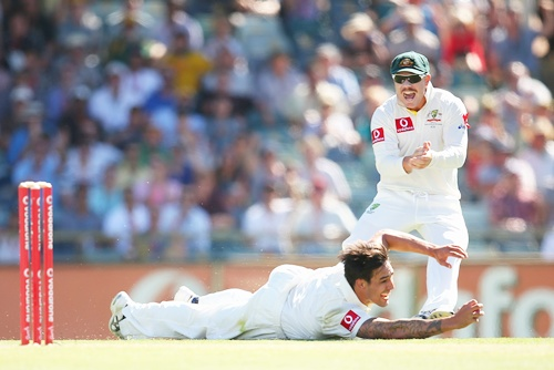 Mitchell Johnson of Australia catches out Alviro Petersen of South Africa