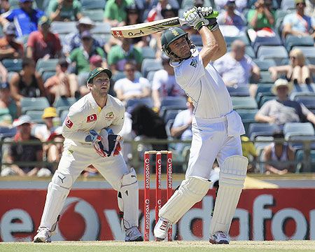South Africa's AB de Villiers hits a six off Australia's Nathan Lyon as keeper Matthew Wade looks on at the WACA