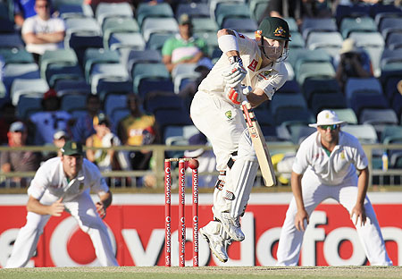 Australia's David Warner (centre) bats during the second innigs at the WACA