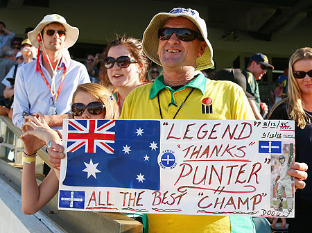 A fan poses with a message for Ricky Ponting during day four of the Third Test between Australia and South Africa on Monday