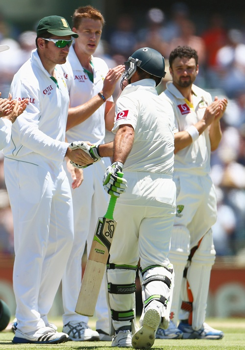Ricky Ponting of Australia is greeting to the wicket by South African captain Graeme Smith