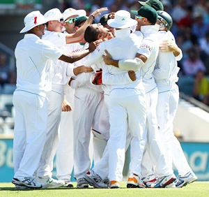 South African players celebrate after winning the Test