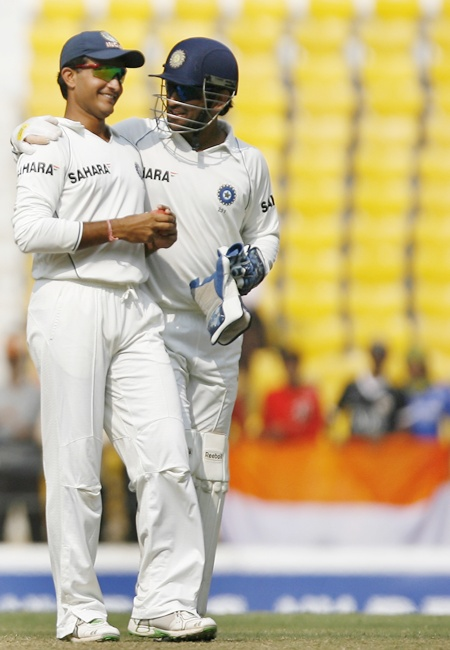 Mahendra Singh Dhoni (right) speaks with Saurav Ganguly
