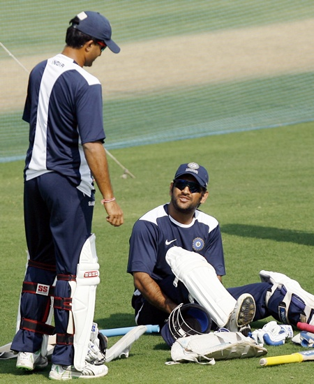 India's Saurav Ganguly (left) speaks with Mahendra Singh Dhoni