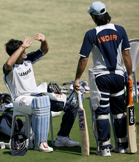 Saurav Ganguly talks with Mahendra Singh Dhoni (right)