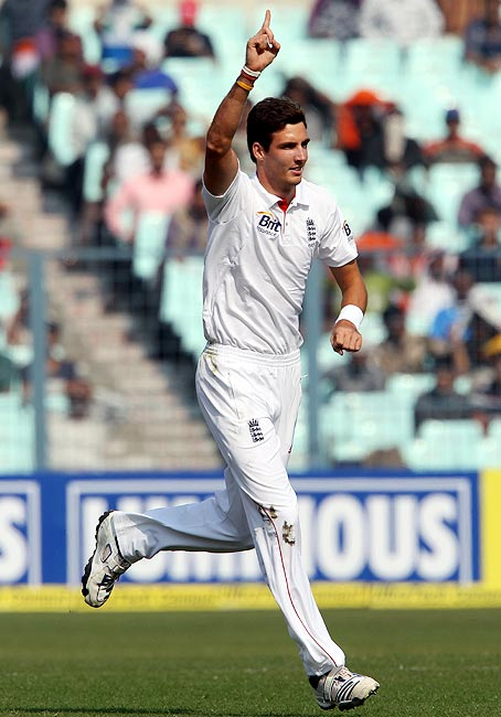 Steven Finn celebrates the wicket of Mahendra Singh Dhoni