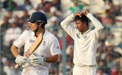 Pragyan Ojha and Alastair Cook
