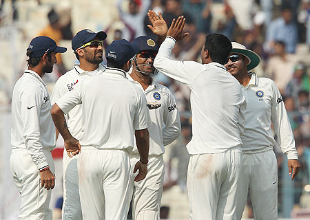 Indian players celebrate after the dismissal of Jonathan Trott