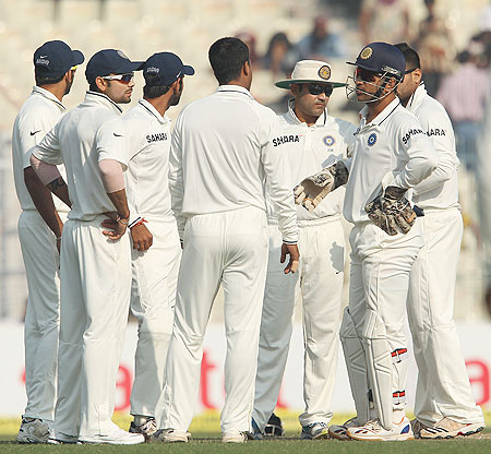 Indian players celebrate after taking the wicket of Graeme Swann