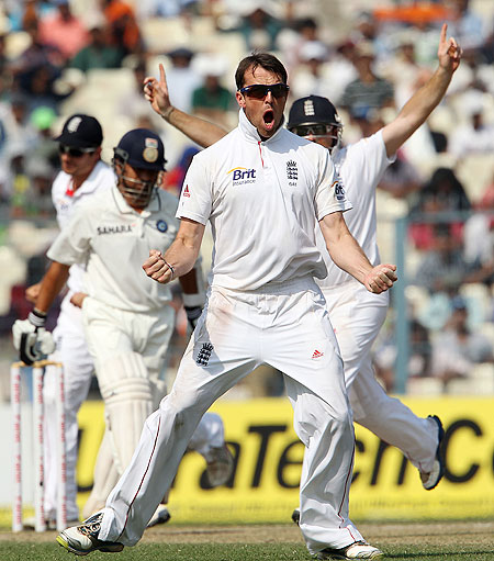 Graeme Swann celebrates after dismissing Sachin Tendulkar