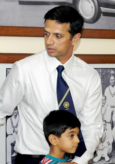 Rahul Dravid walks with his son