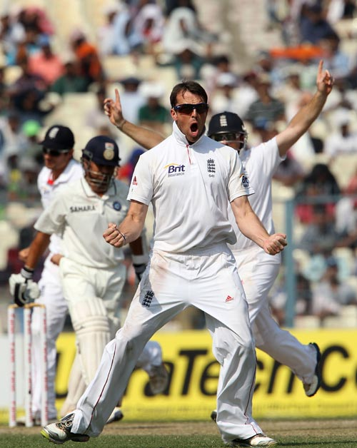 Graeme Swann celebrates after picking the wicket of Sachin Tendulkar