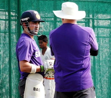 Gautam Gambhir and coach Duncan Fletcher have a word after taking a look at the wicket