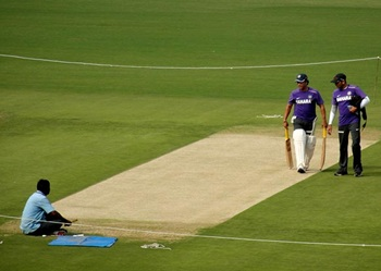 Sachin Tendulkar inspects the pitch at the VA stadium on Tuesday