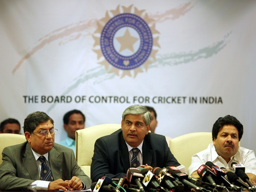 Shashank Manohar, president of the BCCI, speaks as officials Rajiv Shukla (right) and N. Srinivasan look