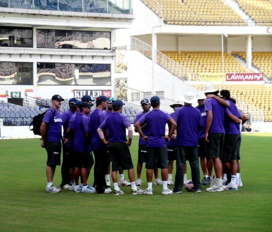 Members of the Indian team and coaching staff have a word at the VCA stadium