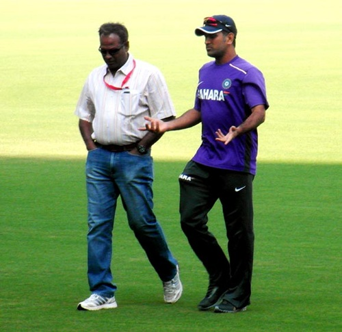 Dhoni with the ground's curator