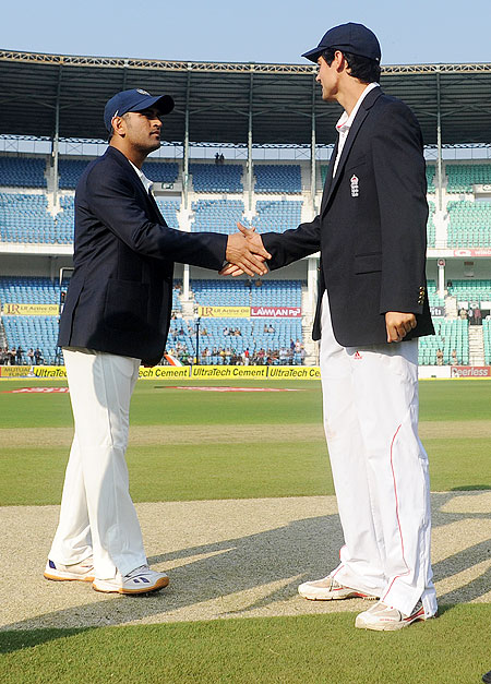 India captain MS Dhoni and England captain Alastair Cook greet each other during the toss, before the start of the 4th Test, on Day 1 at VCA ground in Nagpur on Thursday