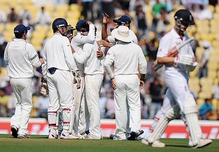 Ravindra Jadeja celebrates with teammates after claiming the wicket of Jonathan Trott on Thursday