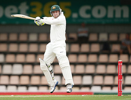 Phillip Hughes of Australia plays a cut shot