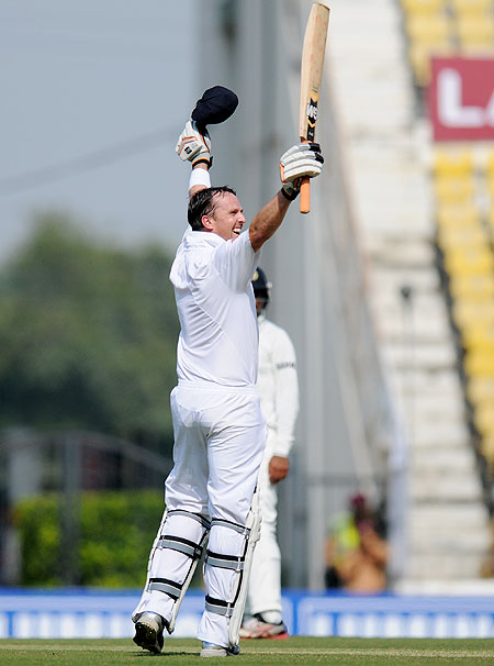Graeme Swann of England celebrates after scoring a half century on Friday
