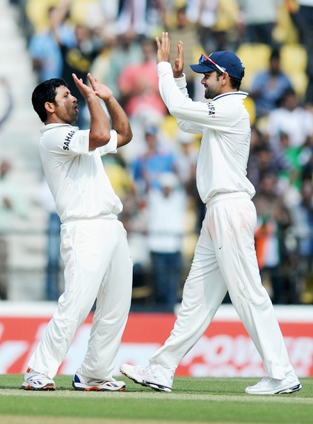 Piyush Chawla celebrates with Virat Kohli after claiming the wicket of Joe Root