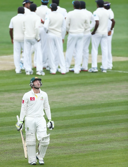 Phillip Hughes of Australia walks from the ground after he was bowled