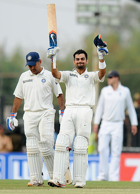 Virat Kohli of India celebrates after scoring a century against England on Saturday